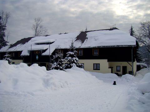 zimně oděná chata KČT v Prášilech