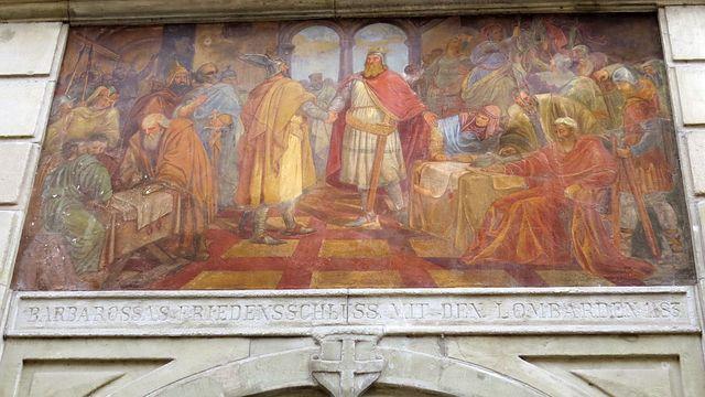 Fridrich I. Barbarossa uzavírá v roce 1183 mír se spolkem severoitalských (lombardských) měst, tzv. Kostnický mír